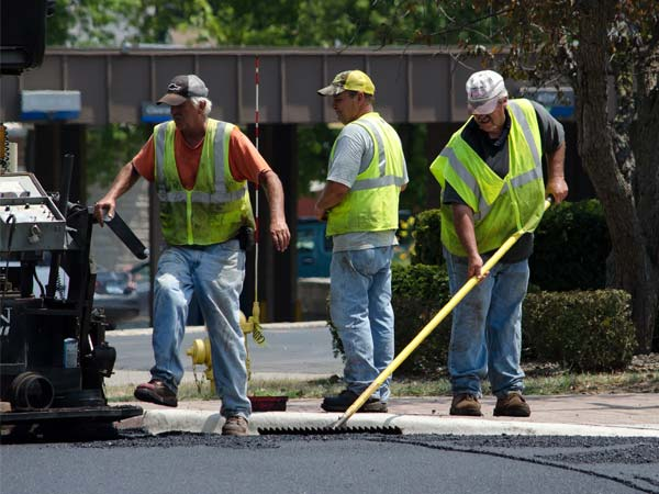 Asphalt paving crew at work